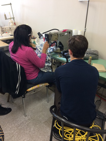 Humber student videographer at Maple Drapery and Carpet showroom