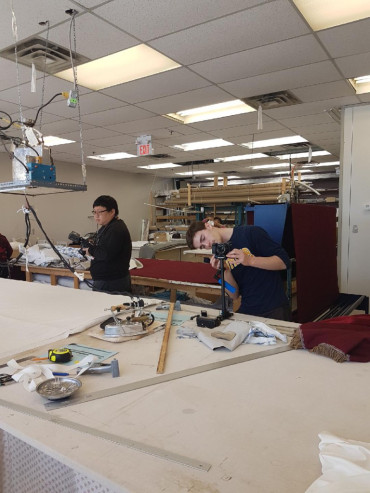 Humber student videographers at Maple Drapery and Carpet showroom